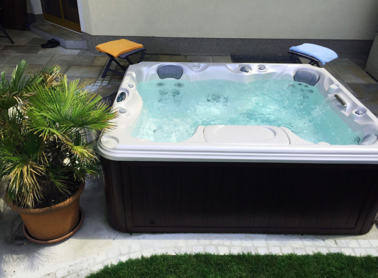 Outdoor hot tub on a patio.